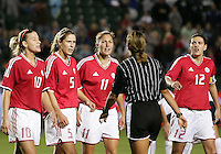 Canadian players protest referee Virginia Tovar's penalty kick call in the last seconds of the second overtime. USA captured the 2006 Gold Cup at Home Depot stadium in Carson, California on November 26 2006 thanks to a penalty kick call by the referee with only seconds remaining in the last period of overtime. With the penalty kick score USA beat Canada 2-1.