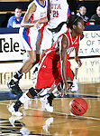 Nicholls State University Colonels guard Ricshamda Bickham (3) dribbles the ball down court  in the game between the UTA Mavericks and the  Nicholls State University Colonels  held at the University of Texas in Arlington's Texas Hall in Arlington, Texas. UTA defeats Nicholls 69 to 62