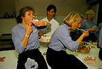 Part time casual employees working as <br /> catering staff at Fishmongers Hall City of London  1992. After the banquet has been cleared away enjoy some food that was left over. The Worshipful Company of Fishmongers hold a  banquet for the fish trade  1992 1990s.