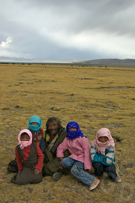 """A Nomad family near Namtso Lake.Namtso Lake :Namtso, another holy lake in Tibet, is located near Damxung. 4718 meters (15475 feet) above sea level and covering 1900 square kilometers (735 square miles), the lake is the highest saltwater lake in the world and the second largest saltwater lake in China. The snow capped Mt. Nyainqentanglha, considered as the son of Namtso and leader of sacred mountains, soars up to sky beside her. Singing streams converge into the clean sapphire blue lake, which looks like a huge mirror framed and dotted with flowers..The Namtso Lake is held as """"the heavenly lake"""" or """"the holy lake"""" in northern Tibet. .Respected as one of the three holiest lakes in Tibet, the Namtso Lake is the seat of Paramasukha Chakrasamvara for Buddhist pilgrims. In the fifth and sixth month of the Tibetan calendar each year, many Buddhists come to the lake pay homage and pray. Deep tracks are worn into the lakeshore due to this activity. In history, monasteries stood like trees in a forest around the site, attracting large numbers of pilgrims as eminent monks in Buddhist temples extended Buddhist teachings...Buddhists believe Buddhas, Bodhisattvas and Vajras will assemble to hold religious meeting at Namtso in the year of sheep on Tibetan calendar. It is said that walking around the lake at the right moment is 100,000 times more efficacious than that in normal years. That's why thousands of pilgrims from every corner of the world come to pray at the site, with the activity reaching a climax on Tibetan April 15...Walking around the lake takes a week. Ritual walkers love to burn aromatic plants to raise smoke on Auspicious Island [explain this a little] and throw a piece of hada scarf into the lake as a token of fulfilled wishes. If the scarf sinks, it implies ones wish is accepted by the Buddha; if the scarf flows on the water or only half sinks, it means one has failed to be honest and something unhappy may lie ahead...On the four sides of the lake stand four mona"""