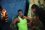 ZANZUR, Libya 5th September 2011:..A Liberian shaves in the camp.  ...Ayman Oghanna