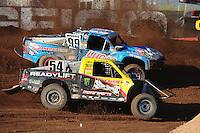 Apr 17, 2011; Surprise, AZ USA; LOORRS driver Rob Naughton (54) races alongside Robby Woods (99) during round 4 at Speedworld Off Road Park. Mandatory Credit: Mark J. Rebilas-
