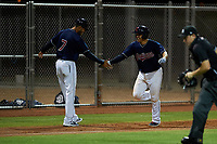 AZL Indians Red Yainer Diaz (4) is congratulated by manager Jerry Owens (7) as he rounds third base after hitting a walk-off home run to end an Arizona League game against the AZL Padres 1 on June 23, 2019 at the Cleveland Indians Training Complex in Goodyear, Arizona. AZL Indians Red defeated the AZL Padres 1 3-2. (Zachary Lucy/Four Seam Images)