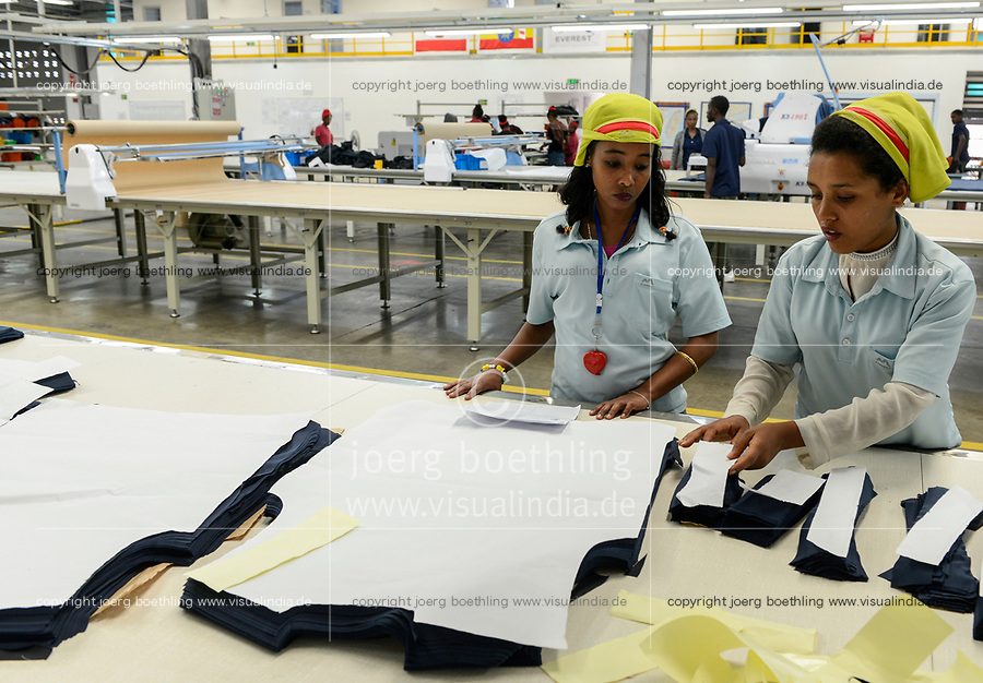 ETHIOPIA , Southern Nations, Hawassa or Awasa, Hawassa Industrial Park, chinese-built for the ethiopian government to attract foreign investors with low rent and tax free to establish a textile industry and create thousands of new jobs, taiwanese company Everest Textile Co. Ltd. , sewing pattern and cutting department / AETHIOPIEN, Hawassa, Industriepark, gebaut durch chinesische Firmen fuer die ethiopische Regierung um die Hallen fuer Textilbetriebe von Investoren zu vermieten, taiwanesische Firma Everest Textile Co. Ltd.