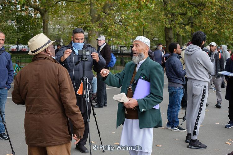 Muslim and Christian preachers argue at Speakers' Corner, Hyde Park, London during the Coronavirus pandemic.