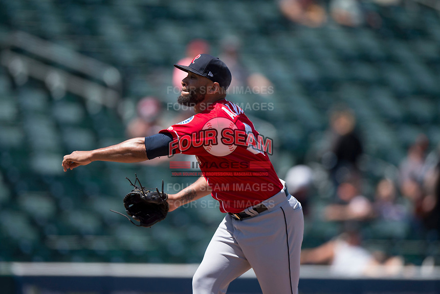 Tacoma Rainiers relief pitcher Dario Alvarez (44) follows through on his delivery during a Pacific Coast League game against the Sacramento RiverCats at Raley Field on May 15, 2018 in Sacramento, California. Tacoma defeated Sacramento 8-5. (Zachary Lucy/Four Seam Images)