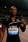 SHANGHAI, CHINA - MAY 19:  Asafa Powell of Jamaica celebrates after winning the Men 100m on May 19, 2012 at the Shanghai Stadium in Shanghai, China.  Photo by Victor Fraile / The Power of Sport Images
