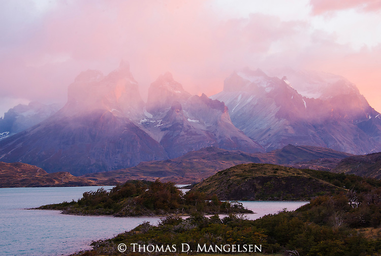 A storm clears above Torres del Paine at sunrise in Patagonia, Chile.