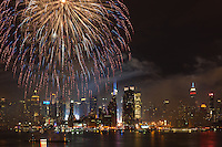 WEEHAWKEN, NJ - JULY 4: The annual Macy's Fourth of July fireworks extravaganza lights the sky over the Hudson river with the Manhattan skyline in the background on Monday, July 4, 2011 as seen from Weehawken, New Jersey on the west side of the river.