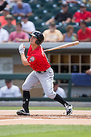 Adam Frazier (6) of the Indianapolis Indians follows through on his swing against the Charlotte Knights at BB&T BallPark on June 19, 2016 in Charlotte, North Carolina.  The Indians defeated the Knights 6-3.  (Brian Westerholt/Four Seam Images)