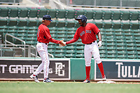 GCL Red Sox right fielder Chad Hardy (25) is congratulated by manager Tom Kotchman (11) as he stands on third base after hitting a triple during a game against the GCL Rays on August 1, 2018 at JetBlue Park in Fort Myers, Florida.  GCL Red Sox defeated GCL Rays 5-1 in a rain shortened game.  (Mike Janes/Four Seam Images)