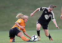 BOYDS, MARYLAND-JULY 07,2012:  Mikaela Howell (8) of DC United Women beats Lauren Hettinger (21) of Dayton Dutch Lions to the ball during a W League game at Maryland Soccerplex, in Boyds, Maryland. DC United women won 4-1.