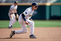 Michigan Wolverines third baseman Blake Nelson (10) on defense during Game 1 of the NCAA College World Series against the Texas Tech Red Raiders on June 15, 2019 at TD Ameritrade Park in Omaha, Nebraska. Michigan defeated Texas Tech 5-3. (Andrew Woolley/Four Seam Images)