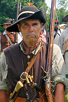 Lebanon Towne Militia men march with shouldered muskets during a drill at a Revolutionary War encampment and muster, the Nathan Hale Homestead, Coventry, Connecticut, USA..