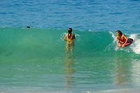 Bodysurfer and boggyboarder at Magic sands beach county park, Kailua Kona, The Big Island of Hawaii
