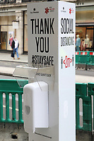 Hand Sanitiser station in Regent Street<br /> Social Distancing, Hand Sanitiser stations and NHS signage around London as Lockdown restrictions are loosened by allowing Pubs, Restaurants and all retail to re-open. London on Saturday July 4th 2020<br /> <br /> Photo by Keith Mayhew