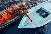 """Sea Watch-2.<br /> Die Sea Watch-2 bei ihrer 13. SAR-Mission vor der libyschen Kueste.<br /> Im Bild: Ein Holzboot wird von einem Crewmitglied der Sea Watch-2 als """"sicher geborgen"""" markiert.<br /> 21.10.2016, Mediterranean Sea<br /> Copyright: Christian-Ditsch.de<br /> [Inhaltsveraendernde Manipulation des Fotos nur nach ausdruecklicher Genehmigung des Fotografen. Vereinbarungen ueber Abtretung von Persoenlichkeitsrechten/Model Release der abgebildeten Person/Personen liegen nicht vor. NO MODEL RELEASE! Nur fuer Redaktionelle Zwecke. Don't publish without copyright Christian-Ditsch.de, Veroeffentlichung nur mit Fotografennennung, sowie gegen Honorar, MwSt. und Beleg. Konto: I N G - D i B a, IBAN DE58500105175400192269, BIC INGDDEFFXXX, Kontakt: post@christian-ditsch.de<br /> Bei der Bearbeitung der Dateiinformationen darf die Urheberkennzeichnung in den EXIF- und  IPTC-Daten nicht entfernt werden, diese sind in digitalen Medien nach §95c UrhG rechtlich geschuetzt. Der Urhebervermerk wird gemaess §13 UrhG verlangt.]"""