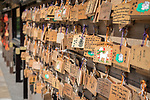 Ema wooden wishing plaques left by visitors at the Shinobazunoike Bentendo Temple, Tokyo, Japan