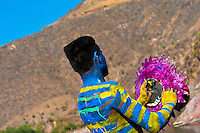 "A Cora Indian man, with body and face painted colorfully, paints his multi-colored hat before the religious ritual ceremony of Semana Santa (Holy Week) in Jesús María, Nayarit, Mexico, 22 April 2011. The annual week-long Easter festivity (called ""La Judea""), performed in the rugged mountain country of Sierra del Nayar, merges indigenous tradition (agricultural cycle and the regeneration of life worshipping) and animistic beliefs with the Christian dogma. Each year in the spring, the Cora villages are taken over by hundreds of wildly running men. Painted all over their semi-naked bodies, fighting ritual battles with wooden swords and dancing crazily, they perform demons (the evil) that metaphorically chase Jesus Christ, kill him, but finally fail due to his resurrection. La Judea, the Holy Week sacred spectacle, represents the most truthful expression of the Coras' culture, religiosity and identity."