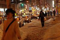 People walking on the street under cold weather in Sapporo, Hokkaido, Japan..Feb 2008