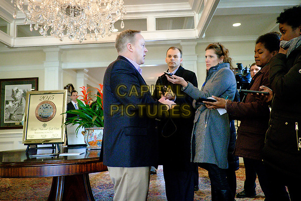 White House Press Secretary Sean Spicer briefs the press pool as United States President Donald Trump has a working lunch with staff and cabinet members and significant others at his golf course, Trump National Golf Club in Potomac Falls, Virginia, U.S., on Saturday, March 11, 2017.  <br /> CAP/MPI/CNP/RS<br /> ©RS/CNP/MPI/Capital Pictures