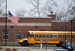 TORRINGTON, CT 17 DECEMBER- 121712JS01- A school bus pulls up to Torringford School in Torrington next to the American flag at half-staff on Monday as local children return to school following the deadly shooting in Newtown on Friday. Jim Shannon Republican American