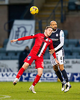 19th December 2020; Dens Park, Dundee, Scotland; Scottish Championship Football, Dundee FC versus Dunfermline; Liam Fontaine of Dundee competes in the air with Declan McManus of Dunfermline Athletic