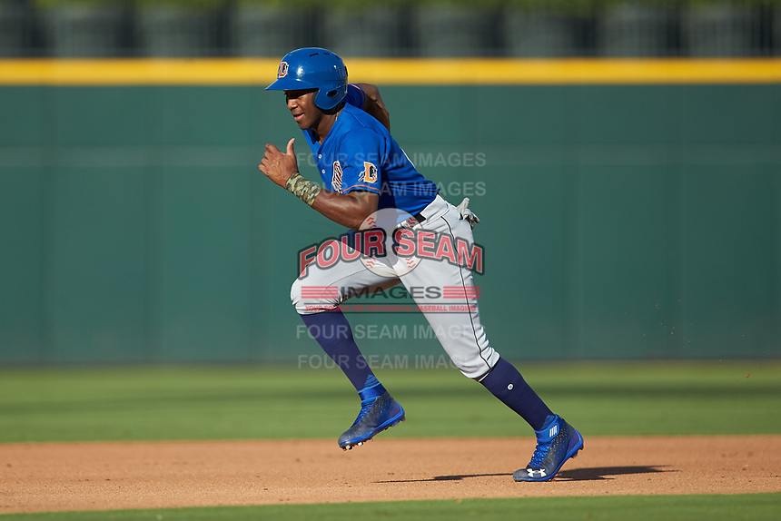 Justin Williams (4) of the Durham Bulls hustles towards third base against the Charlotte Knights at BB&T BallPark on July 4, 2018 in Charlotte, North Carolina. The Knights defeated the Bulls 4-2.  (Brian Westerholt/Four Seam Images)
