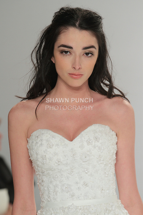"""Beauty shot: model walks runway in Juno - an off white A-line sweetheart tulle dress embellished with silk embroideries on the bodice and belted waist, from the Tony Ward Fall 2016 """"A Mid-Summer Night's Dream"""" bridal collection on April 18, 2016 at Kleinfeld Bridal during New York Bridal Fashion Week Spring Summer 2016."""
