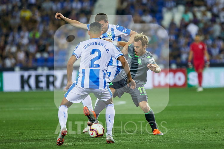 Leganes' Juan Francisco Moreno and Real Sociedad's David Zurutuza during La Liga match. August 24, 2018. (ALTERPHOTOS/A. Perez Meca)