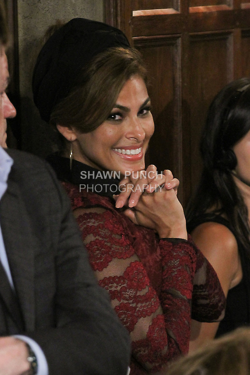 Actress and designer Eva Mendes admires model walking down runway wearing an outfit from her Eva Mendes for New York & Company Spring Summer 2017 collection, on September 6 2016, at Academy Mansion during New York Fashion Week Spring Summer 2017.