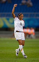 Angela Hucles. The USWNT defeated New Zealand, 4-0, during the 2008 Beijing Olympics in Shenyang, China.  With the win, the USWNT won group G and advanced to the semifinals.