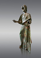 Bronze statue of Roman empress Julia Aquilia Severa found at Sparta. circa 221-222 AD.  Athens National Archaeological Museum, Cat No X23321. Against grey.<br /> <br /> The women in the Bronze statue wears a Chiton and himation and would have had a crwon on her head. The hair style is typical of the Severan dynisty. Julia Aquilia was the last wife of emperor Elagobalus (218-222 AD) and the damage to the statue is due to a building collapsing on it after a fire circa 221-222 AD