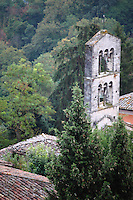 Todi: A particular of the panorama from the terrace of the historical center. This is the beautiful bell-tower of the ancient church of San Carlo (or Sant'Ilario), on the background of green trees.