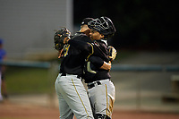 Bristol Pirates relief pitcher Alec Rennard (19) hugs catcher Gabriel Brito (52) after recording the last out of a game against the Bluefield Blue Jays on July 26, 2018 at Bowen Field in Bluefield, Virginia.  Bristol defeated Bluefield 7-6.  (Mike Janes/Four Seam Images)