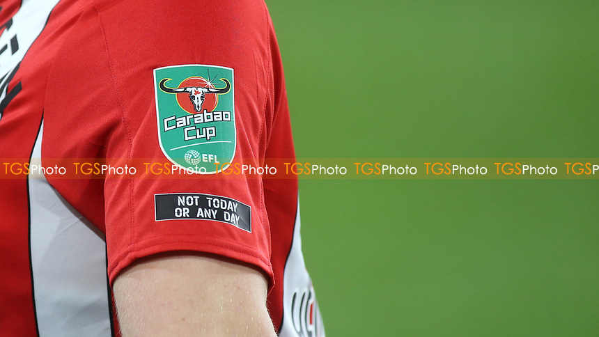 Underneath the Carabao Cup badge on the sleeve of Brentford's Mads Bech Sorensen is a message which reads, Not Today or Any Day during Brentford vs Newcastle United, Carabao Cup Football at the Brentford Community Stadium on 22nd December 2020