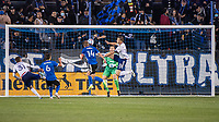 SAN JOSE, CA - MAY 01: Jackson Yueill #14 of the San Jose Earthquakes scores past Frederic Brillant #13 of DC United during a game between San Jose Earthquakes and D.C. United at PayPal Park on May 01, 2021 in San Jose, California.