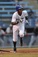 Asheville Tourists shortstop Rosell Herrera #7 runs to first during a game between the Hickory Crawdads and the Asheville Tourists at McCormick Field on April 17, 2013 in Asheville, North Carolina. The Crawdads won the game 6-5. (Tony Farlow/Four Seam Images).