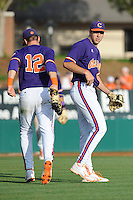 First Baseman Jon McGibbon #12 and pitcher Patrick Andrews #43 congratulate each other at the conclusion of  a  game against the Miami Hurricanes at Doug Kingsmore Stadium on March 31, 2012 in Clemson, South Carolina. The Tigers won the game 3-1. (Tony Farlow/Four Seam Images).