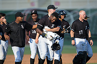 Micker Adolfo (27) of the Kannapolis Intimidators gets a hug from teammate Jake Elliott (37) after his game winning hit in the bottom of the seventh inning against the Hagerstown Suns at Kannapolis Intimidators Stadium on June 15, 2017 in Kannapolis, North Carolina.  The Intimidators walked-off the Suns 5-4 in game one of a double-header.  (Brian Westerholt/Four Seam Images)