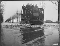 An amphibious vehicle with soldiers and evacues on the road,during Holland Flood of 1953.  (exact date unknown)