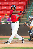 Jordan Akins #5 of the Hickory Crawdads follows through on his swing against the Charleston RiverDogs at L.P. Frans Stadium on April 29, 2012 in Hickory, North Carolina.  The Crawdads defeated the RiverDogs 12-3.  (Brian Westerholt/Four Seam Images)