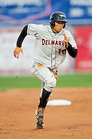 Anthony Vega (16) of the Delmarva Shorebirds hustles towards third base against the Hagerstown Suns at Municipal Stadium on April 11, 2013 in Hagerstown, Maryland.  The Shorebirds defeated the Suns 7-4 in 10 innings.  (Brian Westerholt/Four Seam Images)