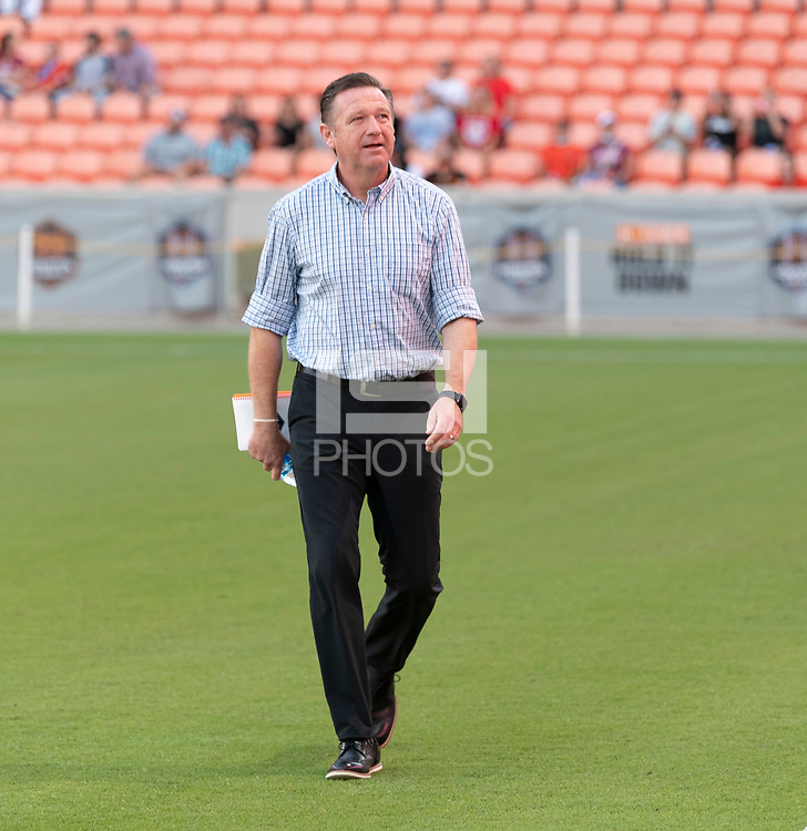 HOUSTON, TX - SEPTEMBER 10: Houston Dash Head Coach, James Clarkson enters the pitch before a game between Chicago Red Stars and Houston Dash at BBVA Stadium on September 10, 2021 in Houston, Texas.