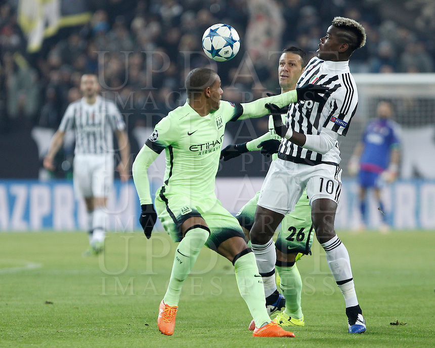 Calcio, Champions League: Gruppo D - Juventus vs Manchester City. Torino, Juventus Stadium, 25 novembre 2015. <br /> Juventus' Paul Pogba, right, is challenged by Manchester City's Fernando, left, and Martín Demichelis, during the Group D Champions League football match between Juventus and Manchester City at Turin's Juventus Stadium, 25 November 2015. <br /> UPDATE IMAGES PRESS/Isabella Bonotto