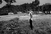 Korineca, Kosovo  <br /> 1999<br /> <br /> Local residents returning home, and NATO troops discover a mass grave of ethnic Albanians killed by Serbian military. Hundreds or possibly thousands of graves such as this are scattered throughout the country.