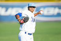 Burlington Royals pitcher Christian Flecha (17) warms up in the outfield prior to the game against the Princeton Rays at Burlington Athletic Park on July 11, 2014 in Burlington, North Carolina.  The Rays defeated the Royals 5-3.  (Brian Westerholt/Four Seam Images)