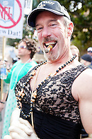 """Jerry Hanford smokes a cigar at the start of a parade in Buddy D's honor on January 31, 2010 in New Orleans.<br /> <br /> Thousands of Saints fans wearing dresses paraded from the Louisiana Superdome to the French Quarter to honor a promise made by the late sportscaster and Saints super-fan Buddy Diliberto aka """"Buddy D"""".<br /> <br /> In 1993 Buddy D, who passed away in 2005, remarked on air that if the Saints were to make it to the Super Bowl, he would wear a dress and dance down the streets.  The comment was repeated at various times and never forgotten by his listeners.<br /> <br /> Led by former New Orleans Saints quarterback Bobby Hebert, who has taken Buddy D's place on WWL radio, thousands made good on his promise for him, dancing, drinking, and cavorting their way down the street, alternately yelling out """"Who Dat!"""" and """"Buddy D!"""" in front of an onlooking crowd an estimated 85,000 people strong.<br /> <br /> The hard luck NFL team the New Orleans Saints has reached its first Super Bowl in team history, after 43 years largely filled with losing seasons and futility.  It is difficult to travel anywhere in the area without some reminder of this fact, as the team and city are intertwined perhaps like no other sports franchise in this country."""