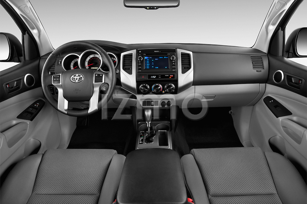 Stock photo of straight dashboard view of 2015 Toyota Tacoma PreRunner 4 Door Pick up Dashboard