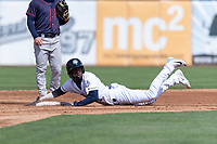Kane County Cougars second baseman Geraldo Perdomo (4) slides into second base in front of Hunter Lee (1) during a Midwest League game against the Cedar Rapids Kernels at Northwestern Medicine Field on April 28, 2019 in Geneva, Illinois. Kane County defeated Cedar Rapids 3-2 in game one of a doubleheader. (Zachary Lucy/Four Seam Images)